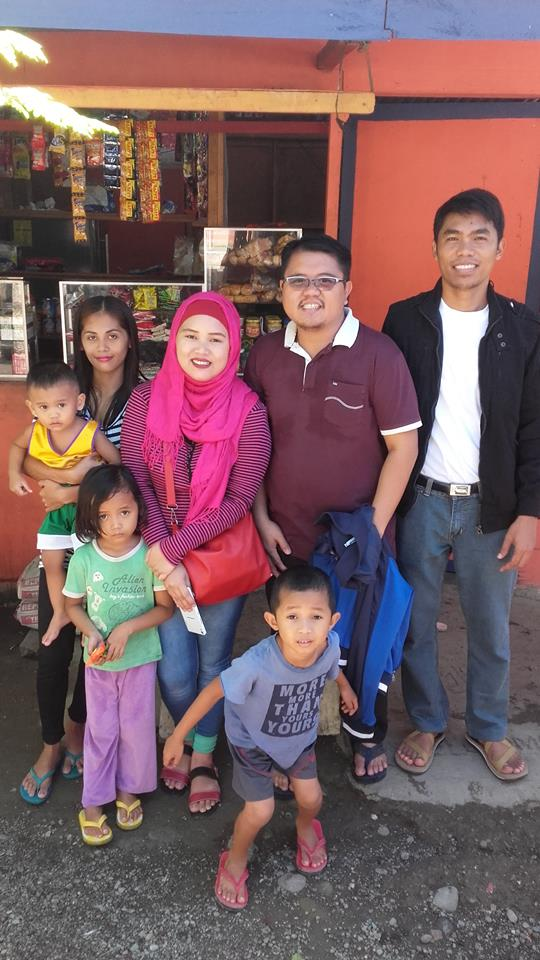 The author, Elbert Balbastro (center), with members of his host Meranao family and with his fellow Columban seminarian, Jerry A Lohera, in Sigayan, Lanao del Norte, Philippines